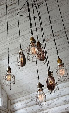varied industrial pendant lighting creates an interesting grouping - this is shown over a dining table in other pictures on this blog