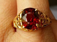 Deep flaming red-orange old Burma (Mogok) Spinel: 4.50cts, unheated. Mounted in Gold.  Gross. Weight: 5.45