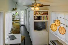 Macy Miller sitting at desk in her tiny house. Click image for slideshow of her tiny house. Tiny House Swoon, Tiny House Cabin, Tiny House Living, Tiny House Design, Tiny House On Wheels, Tiny House Movement, Building A Small House, Green Building, Microhouse