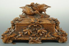Black Forest box with carved figural birds