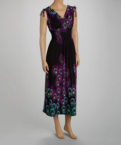 Look fun and flirty in a vibrant maxi. This sleeveless piece boasts a flowing silhouette and rich peacock print that highlight a woman's natural beauty, while the elasticized smocked waist gently hugs the body for a comfortable fit!