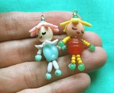 I was looking for some fun dolly pendants for my girls on etsy , and while I ran. - I was looking for some fun dolly pendants for my girls on etsy , and while I ran across some really - Doll Crafts, Bead Crafts, Jewelry Crafts, Cute Jewelry, Beaded Jewelry, Jewellery, Wooden Pegs, Wooden Crafts, Beaded Animals