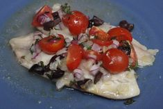 An easy recipe that combines white fish with the Mediterranean flavors of tomatoes, olives, parsley and white wine. We used frozen fish from Trader Joe's.