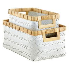 Get a handle on clutter with our super-durable, lightweight baskets made of industrial strapping material. Use them for organizing toys, tv and gaming remotes, accessories, magazines or mail. Each has cutout handles so they're easy to carry and space-efficient when sitting on a shelf. Woven by hand and reinforced with natural bamboo accents, it's a fresh idea for practical storage.