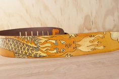 "Awesome dragon pattern, the ""Breathe"" Guitar Strap is handmade leather by Moxie & Oliver.  The original belongs to Chase from Nahko & Medicine for the People!"
