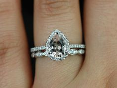 It would be neat to get the engagement ring on the wedding band pictured here.Tabitha and Christie Band White Gold Pear Morganite and Diamonds Halo Wedding Set (Other metals and stone options available) Halo Wedding Set, Wedding Sets, Wedding Bands, Wedding Ring, Dream Wedding, Ring Verlobung, Dream Ring, Bridal Rings, Halo Engagement