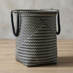 Shop parkay laundry hamper.   Keep laundry out of sight (and out of mind) with this extra roomy, super-sturdy carry all.  Handwoven strips of easy-care plastic zig up and zag around weaving a modern graphic pattern.