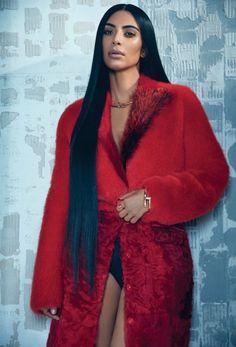 Kim Kardashian poses in red Givenchy fur coat