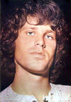 I've never seen a picture of Morrison with the iris of his eyes showing this much! He has blue eyes but almost every picture of him shows him with very huge dilated pupils, almost entirely black. This is truly an incredible photo.