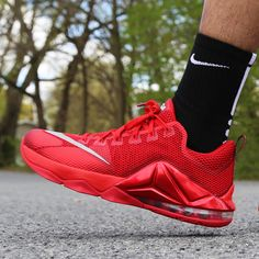 buy online 9c1b1 c87dc New Nike LeBron 12 Low in a red on red styling for the summer.  175
