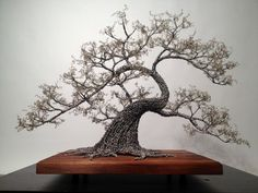 By Kue King; wire sculpture with wire or real leaves
