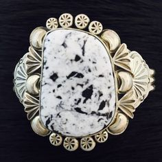 Native American handmade White Buffalo and Sterling Silver bracelet by Najavo artist Mary Ann Spencer. This bracelet has a large stone and beautiful silver work and can be adjusted to fit most wrists.