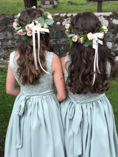 pretty sage green bridesmaid dresses with fresh flower crowns.