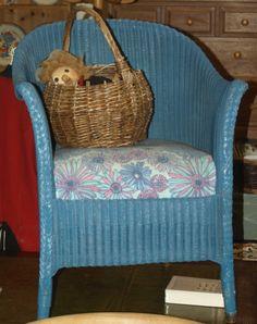 Blue Lloyd Loom chair.