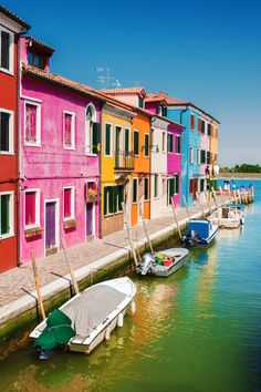 Heading to Italy? Visit Burano, an enchanting fishing island of brightly-colored homes on the Venice lagoon, learn about its traditions and history, and more!