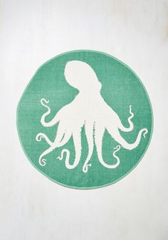 In the depths of your interior decorating lies a most majestic item - this octopus rug! A true creature of 'habitat,' this circular floor mat - with its soft green and white tones - treats your toes to the fun of an underwater adventure without ever leaving home.