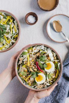 Crunchy Veggie Bowl with Warm Peanut Dressing - A bowl of crunchy veggies…