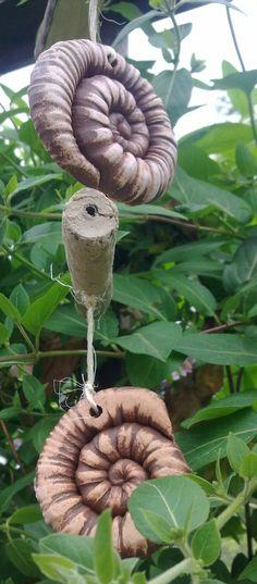 http://de.dawanda.com/product/19214749-Ammonit-Girlande-Haengestele-Holz-Ton-Gartenkeramik