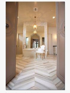 Leather studded door, herringbone floor, shell mirror, tub, Gorgeous