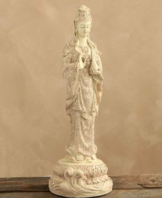 Measuring inches high, this antique style Kuan Yin statue is a prominent yet peaceful presence in your home. Made of a sturdy cast stone with an ivory-colored finish. Angel Sculpture, Persian Blue, Lotus Design, Mother Goddess, Cast Stone, Guanyin, Vase, Statue, Buddhism