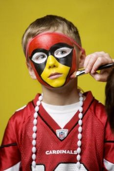 Luke Faherty, 6, gets ready for Super Bowl Sunday with a classic Cardinals face painting.