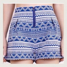 "Listing Aztec Print Shorts Has pleats and zipper in front. Inseam 1.5"" and waist is 13"". 60% cotton and 40% poly. Pair with a cute white crop. Had a large elastic band in back. Umgee Shorts"