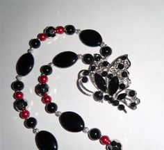 "Black & silver butterfly necklace, black, silver & red beads 18.1/2"" long (47cm)"