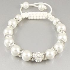 We're taking the Shamballa bracelet to the next level! This beautiful handmade bracelet features an Austrian crystal Shamballa bead with 12 faux pearl beads leading down to the cord. Each bead is divi