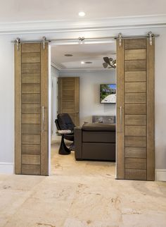 TruStile Barn Doors TM13000 in White Oak with a cerused finish. Custom renovation designed and built by Foglia Custom Homes