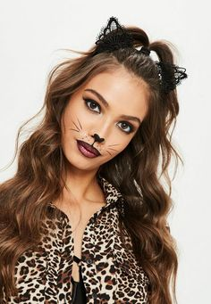 Black headband in a cat ear style, with a lace fabric and versatile black hue.