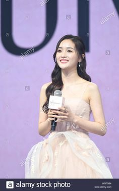 Download this stock image: Chinese singer Wu Xuanyi of South Korean-Chinese girl group Cosmic Girls and Chinese girl group Rocket Girls 101 attends a promotional event in Shangh - W5FG94 from Alamy's library of millions of high resolution stock photos, illustrations and vectors.