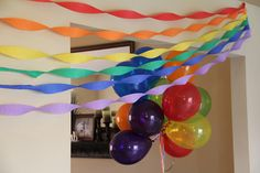Super cheap decoration that made a huge impact: streamers of each color of the rainbow and rainbow balloons