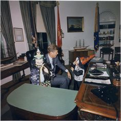 John Jr. and Caroline surprise their dad, President John F. Kennedy, in the Oval Office here in this Halloween 1963 photo. What makes this photo even more poignant was that a mere three weeks later, President Kennedy was assassinated in Dallas on November 22, 1963.