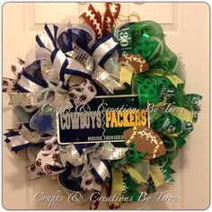 Dallas Cowboys Greenbay Packers housedivided football wreath. More wreaths can be found on my Facebook page: www.facebook.com/CraftsandCreationsByTerri or go to my Etsy page https://www.etsy.com/shop/CreatedByTerri