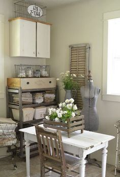 laundry room an old wooden shoe rack holds baskets full of linens
