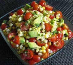 Grilled corn, tomato & avocado salad with honey lime dressing- I would add grilled shrimp to this and make it a meal!