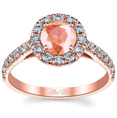 Morganite halo engagement ring with round center stone.  Yes, please!