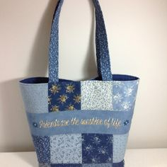 """Tote bag I made using charm squares. I machine embroidered """"Friends are the sunshine of life"""" on one side and my dear friends initials on the other. It's going to make a wonderful shop hop tote!"""