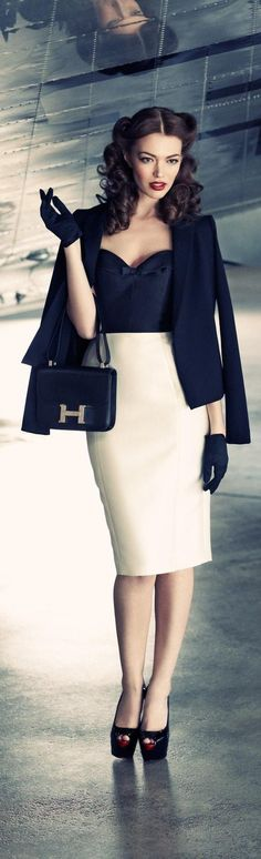 Nude and navy in a look reminding of forties: pencil skirt, bustier, short blazer, pumps and mini bag. More