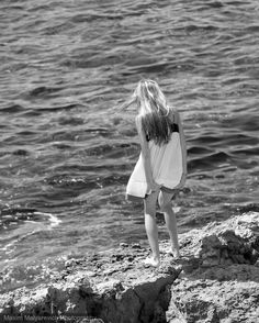 A young girl near the sea.  #monochromatic #blackwhite #woman #girl #black #white #monochrom