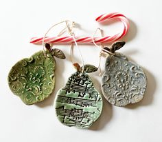 Thrown Pottery Christmas Ornaments bell | Handmade Spark - MissPottery - Clay Pears, Musical Notes, Embossed ...