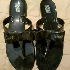 "COACH sandals Black sandals with bow on top ""coach"" written on bow says size 10 but I'm a 9 and fit perfect.. Coach Shoes Sandals"