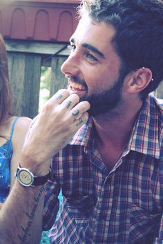 Makes perfect boyfriend for me.  Striking eyes, Industrial piercing, Beard and the tattoos!