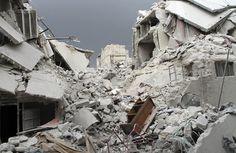 Damaged buildings, after air force shelling in the Karam Al-Tarrab neighborhood near Aleppo International Airport, on February 15, 2013. (Reuters/Malek Al Shemali)