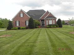 Custom Built Brick Home on .92 Acres of land offers 4 spacious bedrooms 2.5 baths Large Bonus Room and a Huge 20x40 Walk-in Attic that was built to be finished. You will love the Open and Airy floor plan as this home offers 10 ceilings on the main level and the popular split bedroom plan. The living room offers a rock fireplace and custom bookshelves. You will love the kitchen that offers granite Tile backsplash eat at bar and breakfast nook. Screened in Gazebo offers a hot tub. Must See…