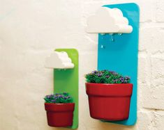 Rainy Pots, whimsical indoor flowerpots that use a gentle rainfall effect to distribute water to plants.