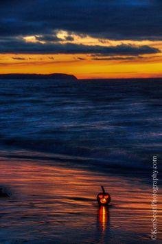 Jack-o-lantern on a Lake Michigan beach on Halloween