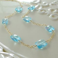 Bright Blue Topaz Necklace Genuine Semiprecious Gemstone Rectangles AAA December Birthstone Wire Wrapped Gold Jewelry Complimentary Shipping. $65.00, via Etsy.