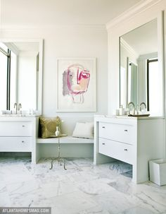 Beautiful vanities.  Love the artwork.  Corner Seat?  So clever.