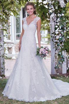 Wedding gown by Rebecca Ingram.